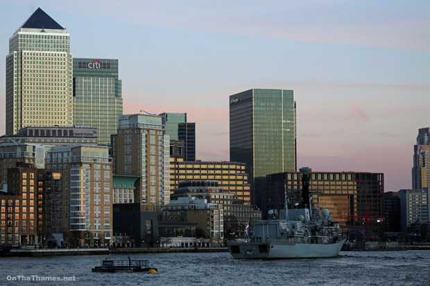 Seen passing Canary Wharf as she departs