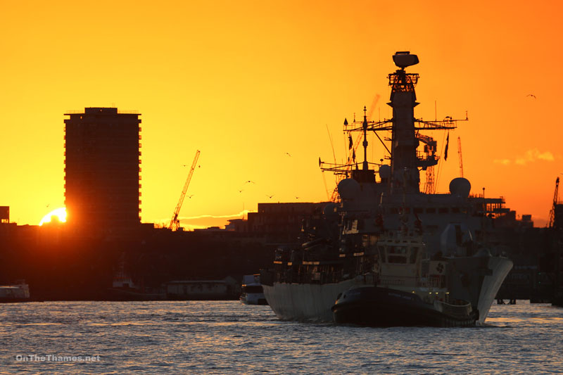 HMS ARGYLL with the sun setting behind