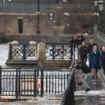 River washes over paths as tide rises high