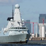 HMS Defender sails out of London