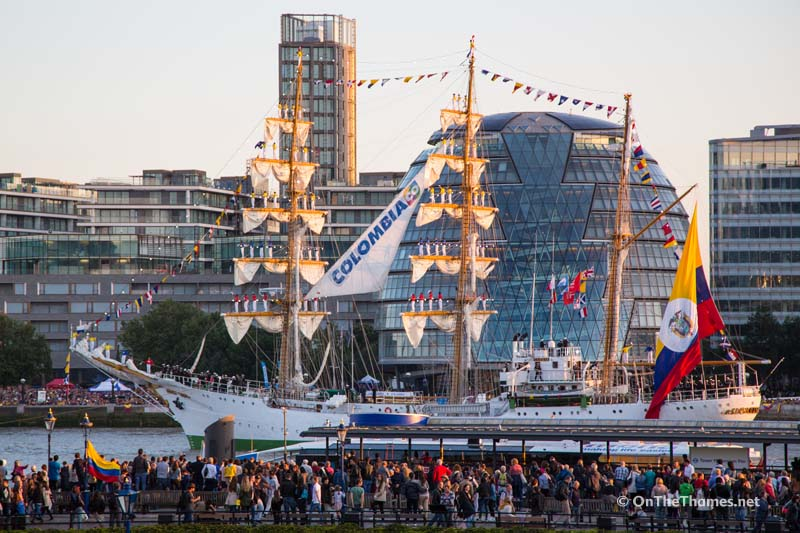"The banks of the River Thames were packed with spectators to see the Colombian flagship ARC Gloria go through Tower Bridge to celebrate Colombia Day. The three masted sail training ship had 67 crew members balancing on the masts singing the Colombian national anthem as she sailed under Tower Bridge at 7pm and back under at 7.30pm as the sun set behind her. The ship has been in London for several days. Onlookers enjoyed the spectacle on an evening of warm late summer sunshine. The ship has a crew of 150, including 67 final-year cadets from the Colombian Naval Academy and one dog ""Black Pearl"" the sailing black Labrador and the flagship's mascot. Credit : Rob Powell/LNP"