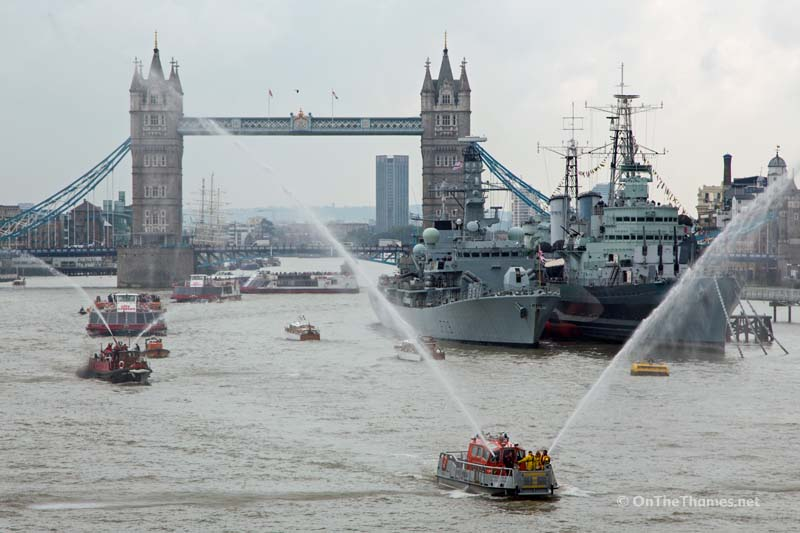 © Licensed to London News Pictures. 09/09/2015. A flotilla of boats has been seen on the Thames today to mark the Queen becoming Britain's longest reigning monarch ever. The flotilla of boats included the Queen's row barge Gloriana, Havengore which carried Churchill body on the day of his funeral and the steamship George Stephenson. Classic fireboat and Dunkirk hero Massey Shaw and a modern fireboat were also present, pumping water in to there. Crowds packed on to bridges to see the spectactle. Credit : Rob Powell/LNP