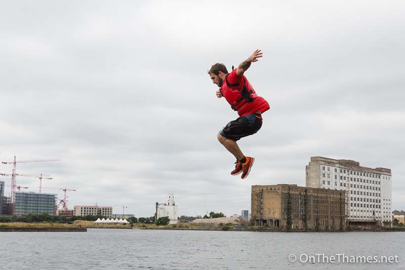 Contestants take part in the London River Rat Race at Royal Victoria Docks on the River Thames