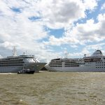 Cruise ships Silver Wind and Silver Cloud pass each other on the River Thames